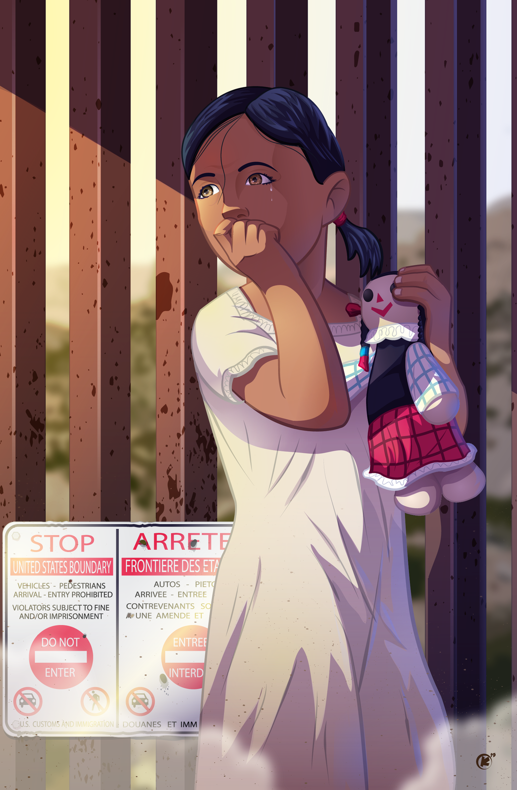 A young migrant girl standing outside the border wall of the United States